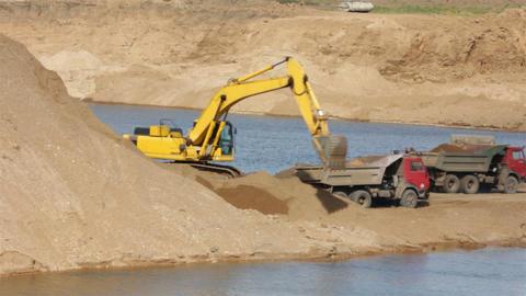 sandpit - loader dump tipper loads of sand Stock Video Footage