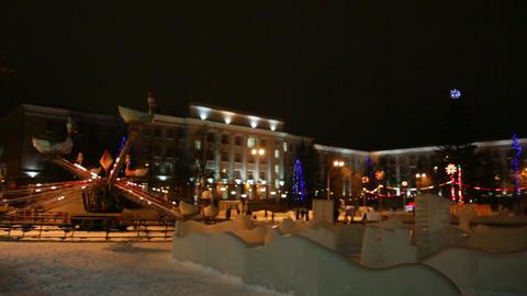 christmas fir and illuminated carousel Stock Video Footage