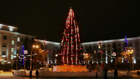 christmas fir on town square at night - timelapse Stock Video Footage