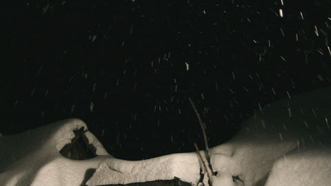 night snowfall and snow-covered roof Stock Video Footage