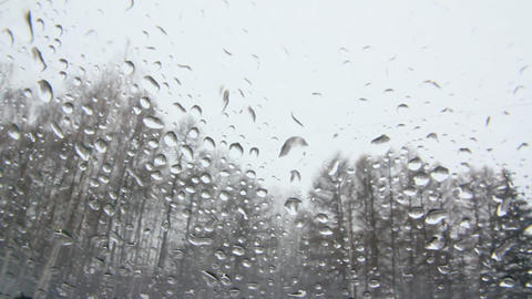 window glass with raindrops and snow Stock Video Footage
