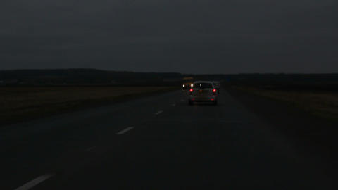 driving on night road with headlights Stock Video Footage