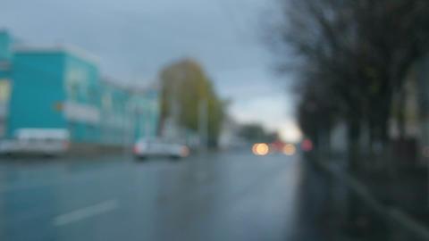 defocused cars moving on street at rain Stock Video Footage