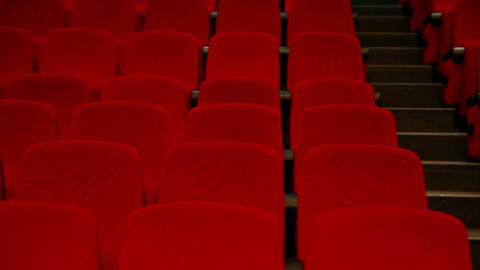 empty auditorium - red chairs in rows Footage