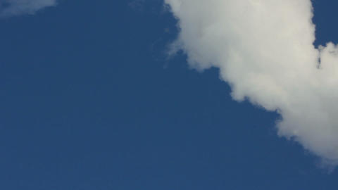 smoke from chimney under blue sky - timelapse Stock Video Footage
