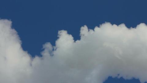 smoke from chimney under blue sky - timelapse Stock Video Footage