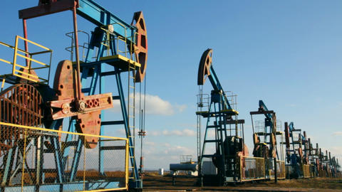 row of many working oil pumps Stock Video Footage