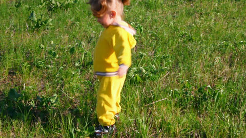 little girl playing with ball on meadow Stock Video Footage