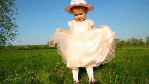 happy little girl in dress on meadow Stock Video Footage