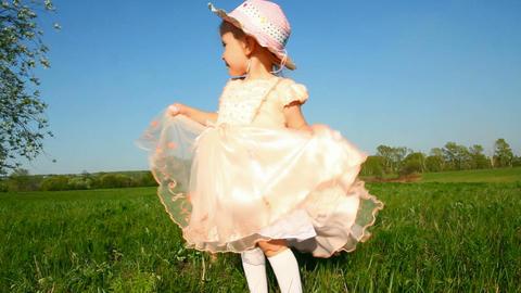 happy little girl in dress on meadow Footage