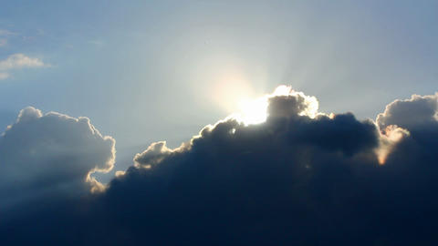 timelapse with sun behind clouds Stock Video Footage