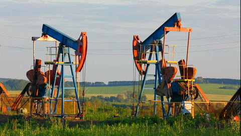 two working oil pumps - timelapse Stock Video Footage