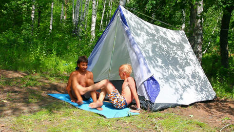 camping children near tent in forest Stock Video Footage