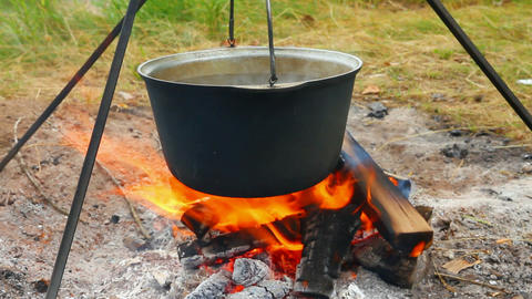 kettle over campfire Stock Video Footage