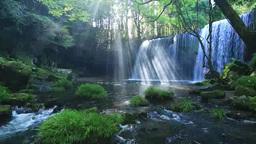 A beam of light at Nabegadaki waterfall Footage