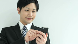 A businessman using a Smartphone 영상물