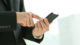 The hands of a businessman using a smart phone Filmmaterial