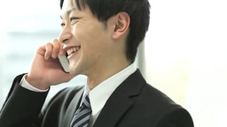 Businessman speaking by mobile phone Footage