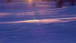 地吹雪と夕景の雪面 Stock Video Footage