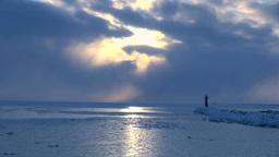 灯台と流氷の海と光芒 Stock Video Footage