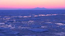 流氷と国後島の夜明け Stock Video Footage