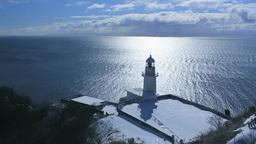 地球岬の光る海とチキウ岬灯台 Stock Video Footage