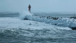 冬の荒れる海と灯台 Stock Video Footage