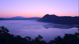 Foggy Lake Mashu at dawn Stock Video Footage