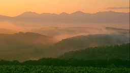 Hills and the Tokachi mountain range in morning mist Stock Video Footage