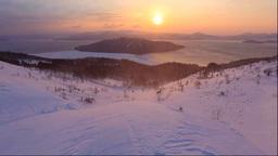 美幌峠から屈斜路湖の日の出と地吹雪 Stock Video Footage