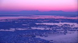 Drift ice and Shiretoko mountain range seen from Notoromisaki in the morning glo Footage