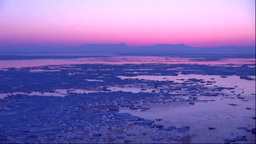 Drift ice and Shiretoko mountain range seen from... Stock Video Footage