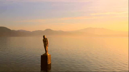 Tatsuko Himezo statue and the dawn of Lake Tazawa Stock Video Footage