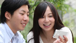 Young couple looking at a smartphone Footage