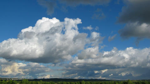 timelapse with clouds moving over far town Stock Video Footage