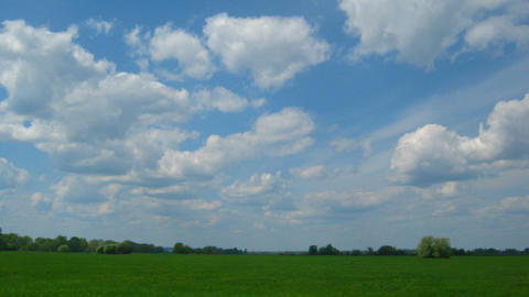 timelapse with clouds moving over green meadow Stock Video Footage