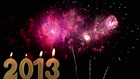 Happy New Year 2013, Candles burn against fireworks, time... Stock Video Footage