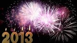 Happy New Year 2013, Candles burn against fireworks, time lapse Footage