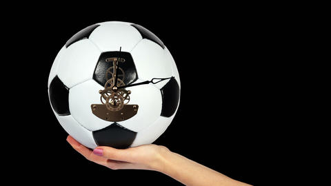 Soccer Ball Clock on the hand, on the black background,... Stock Video Footage