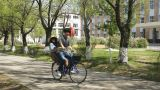 Young Chinese Couple Riding a Bicycle Footage