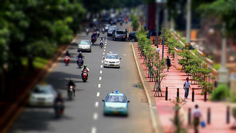 10703 indonesia city traffic tilt shift time lapse Stock Video Footage