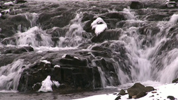 Waterfall Over Rocks In Winter stock footage