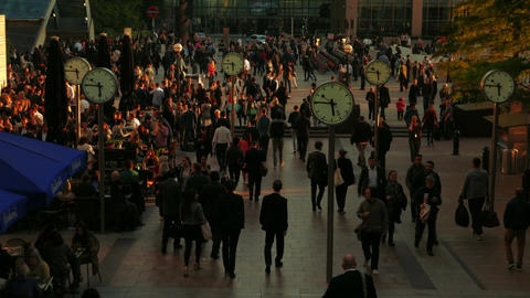 Ticking Clocks at Canary Wharf During Rush Hour in London, UK Footage