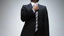 Businessman tightening his tie Footage
