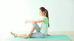 A woman doing yoga Footage