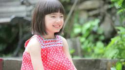 Half-Japanese girl sitting on stairs Footage