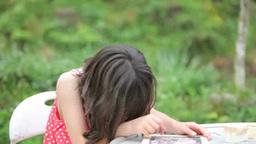 Half-Japanese girl drawing on a blackboard Footage