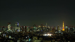 Tokyo Sky Tree lit up (Trendy) and Tokyo Tower at night Footage