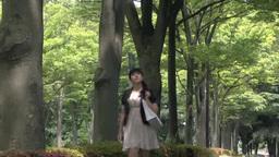Young woman walking in Tokyo, Japan Footage