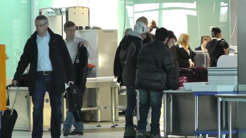 Helsinki Vantaa Airport 12 security check handheld Stock Video Footage